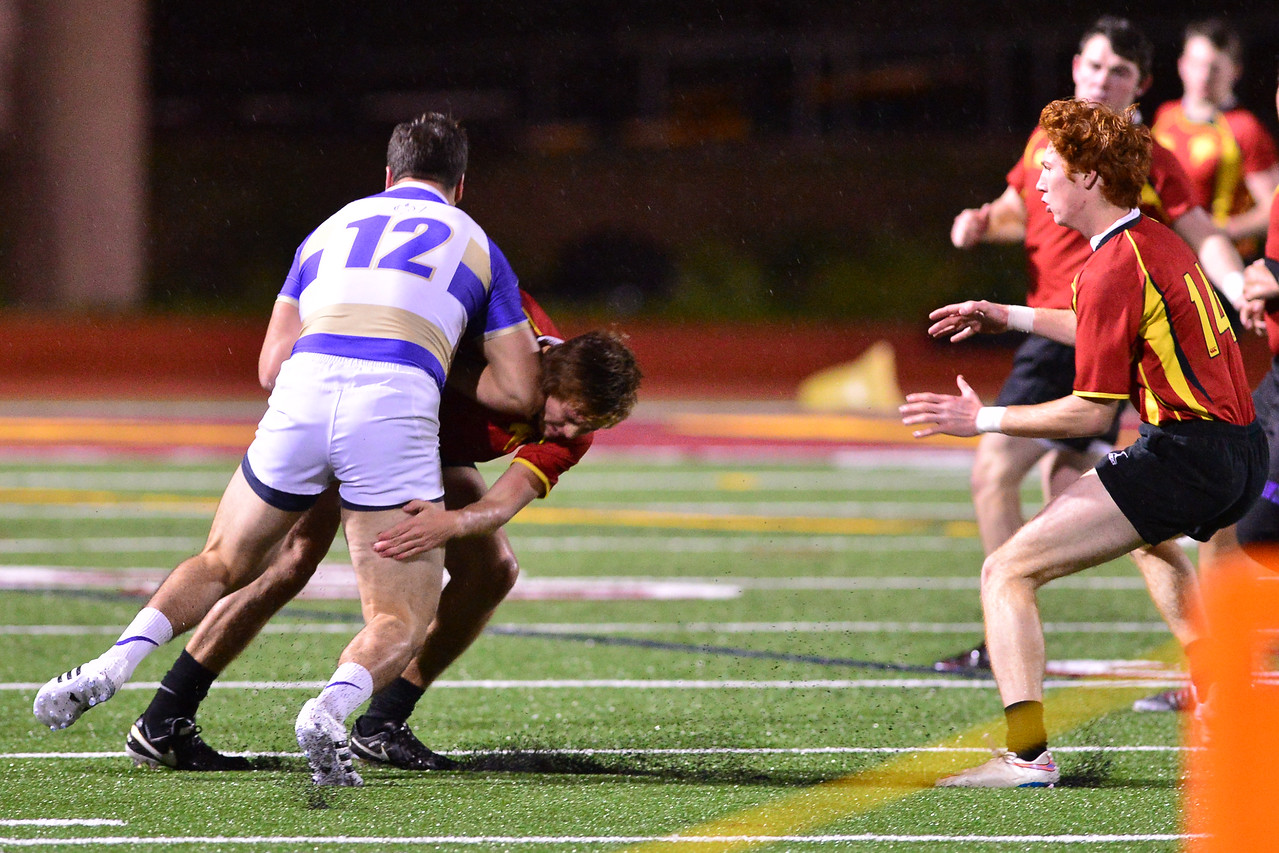Andrew Alves for St. Augustine rugby tackled by Torrey Pines defender. Anna Scipione photo.
