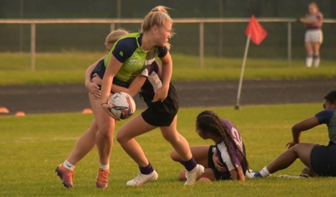 Avery Morgan looks to make an offload in Idaho's girls 7s action.