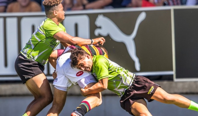 Blake Gilbert making a tackle in the World School 7s. BE Sports Photography.