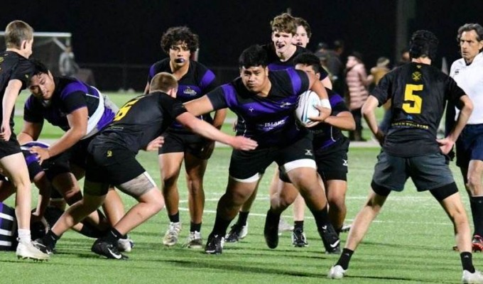 Alex Patolo for Carlsbad pushes off some attention.