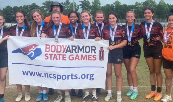 Charlotte Tigress pose after winning the state games.