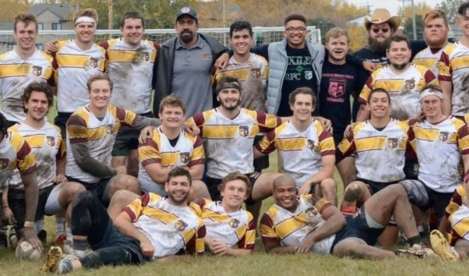 Central Michigan, muddy, tired, and smiling.