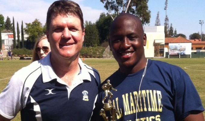 Steve Hiatt, left, presents Cal Maritime player Michael Mukuru with his confefence MVP award.