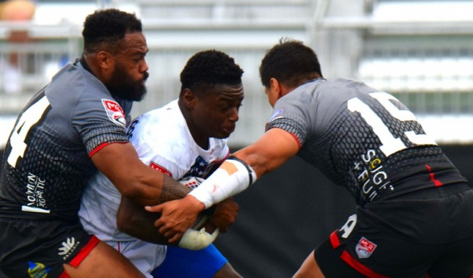 A quick and powerful runner. D'montae Noble scored his first try for DC against RUNY. David Hughes photo.