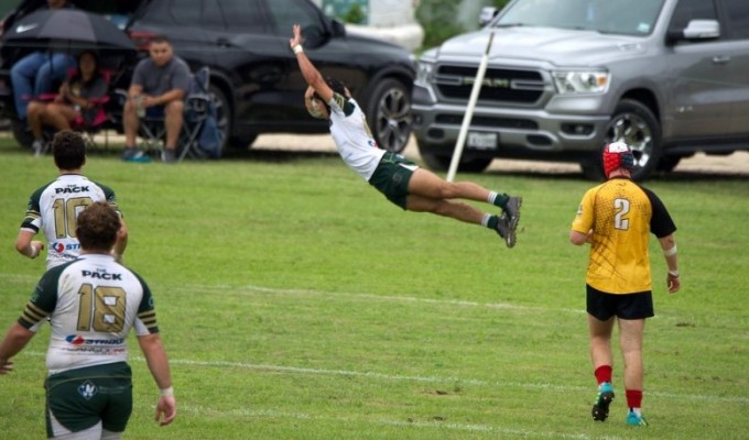 Lane O'Brien soards in for a try for Woodlands. Richard Clarke photo.