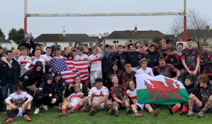 Marin and Llantwit Maor players hang out after the game.
