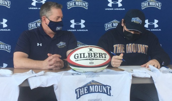 James Stelluti signs with Mount St. Mary's.