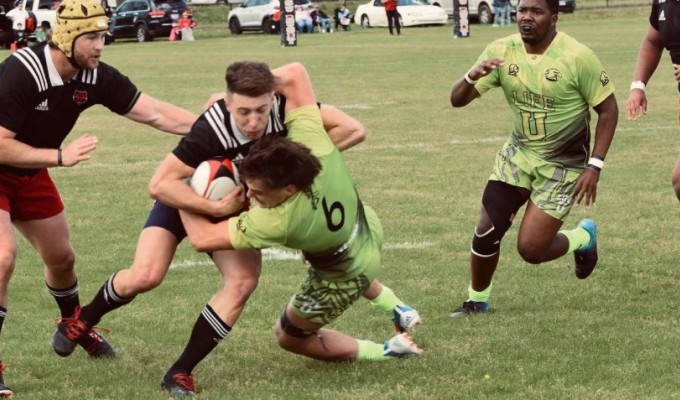 TJ van Rensburg gets some attention from the Life University defense. Photo ASU Rugby.