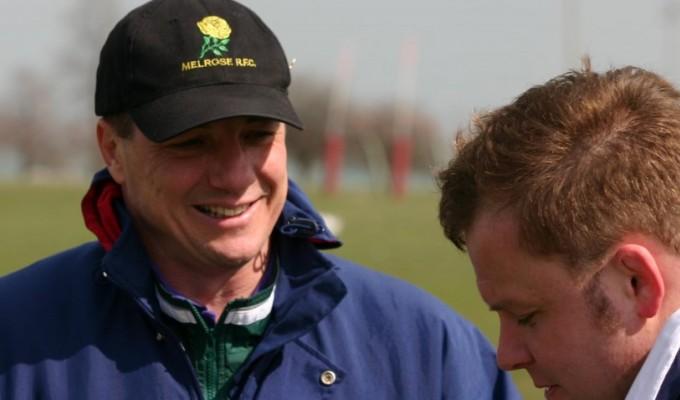 Tom Schmitt all smiles as he coaches.