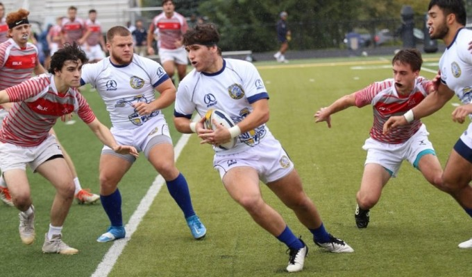 Tomasso Lorenzetti finds some space. Photo Marian University Rugby.