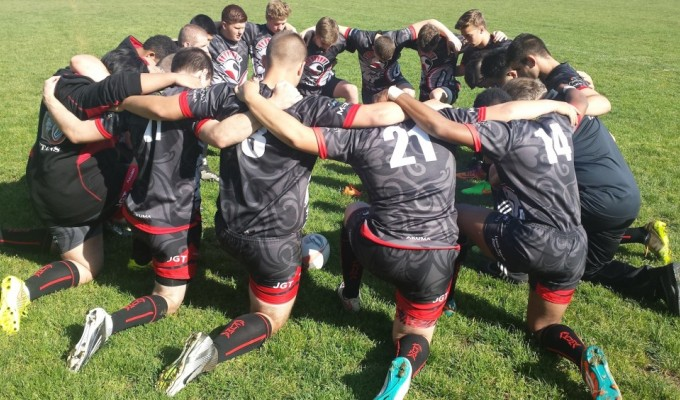 Union HS in Rugby oregon huddles up in 2015.