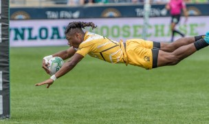 Royaal Jones of AIC soars in for a try during the 2017 CRC in Chester, Pa. Colleen McCloskey photo.