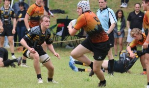 Bruton Peacock charges ahead for Charlotte against Aspetuck. Photo Charlotte Tigers.