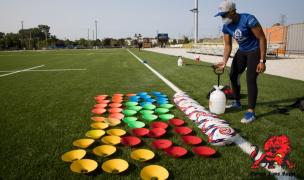 Maks up and spray 'em down. Photo courtesy Chicago Lions.