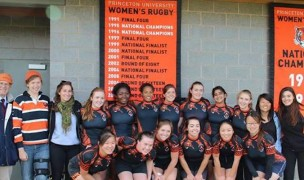 The 2013 Princeton 7s team poses in front of banners touting the programs acheivements.