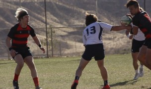 Genesis, in red and black, takes on Snow Canyon. Photo Snow Canyon Rugby.