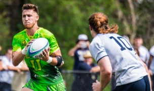 George Phelan takes a pass against Queens University. Photo Life University Rugby.