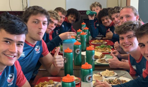The HS All Americans at mealtime in New Zealand.