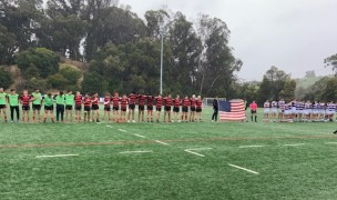 Jesut at left, and St. Augustine, at right, line up for the anthem before the game.