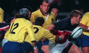 Mark Scharrenberg garners some attention against Romania in the 1999 Rugby World Cup. Photo INPHO