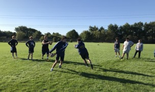 Neuqua Valley working on their handling skills as touch rugby returns to Illinois.