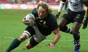 South Africa's Werner Kok scores a try against Fiji in Singapore. Mike Lee - KLC fotos for World Rugby