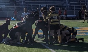 Withrow (black and red) scrums down against Walnut Hills.