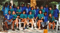 Chris Harju standing, far left and laughing, in Fiji with the Atlantis team in 1992.