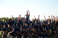 The 2012 USA U20 team raising the Junior World Trophy. P. Crane photo.