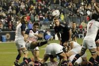Mike Petri launches a box kick against the Maori All Blacks in 2013. Mike Bobis photo.