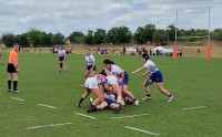 The U18 Girls battle it out in the ruck.