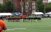 Belmont Shore and Rhinos stand for the National Anthem. Alex Goff photo.
