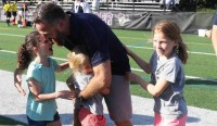 Greg Bruce celebrates Belmont Boys 2019 MIAA state title with niece Rhys and daughters Kai and Zoe.