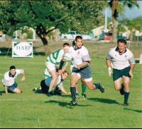 LChris Lippert charging ahead in support for OMBAC. Photo US Rugby Hall of Fame.