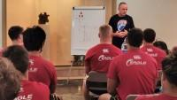 Head Coach Salty Thompson leads a classroom session. Photo Varsity Tours www.varsityse.com.