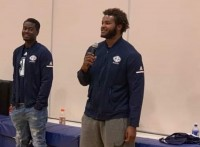 Iowa Central player Elijah Hayes speaking to kids at a local middle school.