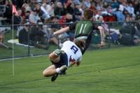 Caden Syddall tackles Olympus speedster Jackson Bennee. Photo Tonio McPeak.