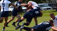 James Hughes makes a tackle for UMW. David Hughes photo.
