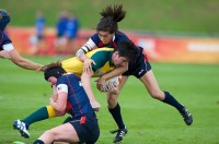 Jossie Tseng makes a tackle during the USA's defeat of Australia in the 2014 RWC. Ian Muir photo.