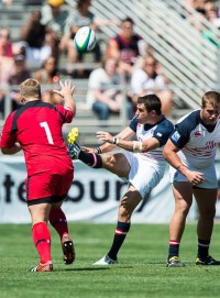 Mike Petri launches a kick against Canada in 2014. David Barpal photo.
