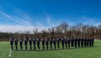 Navy Midshopmen honor the flag. Colleen McCloskey photo.