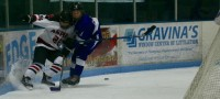 Vincze, in blue, for her Summit HS hockey team.