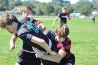 Matt Cleland and Cole Boyer combine on a tackle.