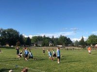 Kids in action at the City of Star touch rugby event.