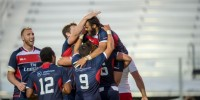 Mike Te'o is congratulated by his teammates after scoring against Russia. David Barpal photo.