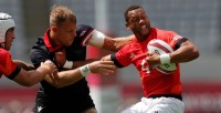 Team GB's Dan Norton fends off the Canada co-captain Harry Jone. Photo Mike Lee - KLC fotos for World Rugby