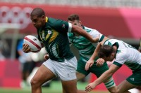 South Africa's Zain Davids bursts through the Ireland defense. Photo Mike Lee - KLC fotos for World Rugby