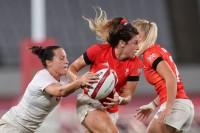 Team GB co-captain Abbie Brown attacks against USA in their medal quarterfinal. Photo: Mike Lee - KLC fotos for World Rugby