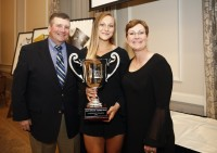 McKenzie Hawkins received the award in 2018, and poses with her trophy and her parents at the WAC in Seattle.