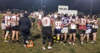 Wilson and Saint Anthony's players huddle up as a group after the game.